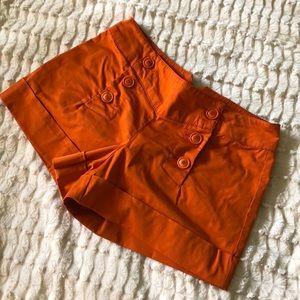 Trina Turk short orange shorts with button front
